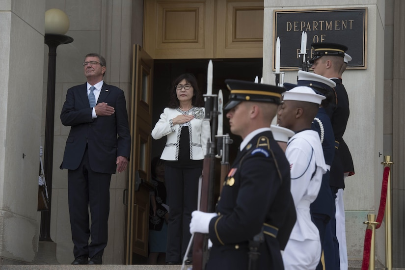 Defense Secretary Ash Carter and Japanese Defense Minister Tomomi Inada stand for the national anthem at the Pentagon, Sept. 15, 2016. Carter hosted an enhanced honor cordon to welcome Inada to the Pentagon. DoD photo by Navy Petty Officer 1st Class Tim D. Godbee