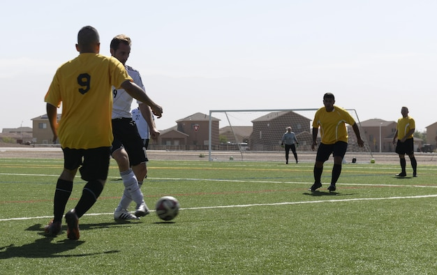 Soccer players from both the U.S. and German air forces compete during the annual soccer match at Holloman Air Force Base, N.M. on Sept. 10, 2016. Each year prior to the Oktoberfest, Holloman Airmen and the German air force compete in a friendly match to showcase their athletic abilities on the soccer field. (U.S. Air Force photo by Airman Alexis P. Docherty)