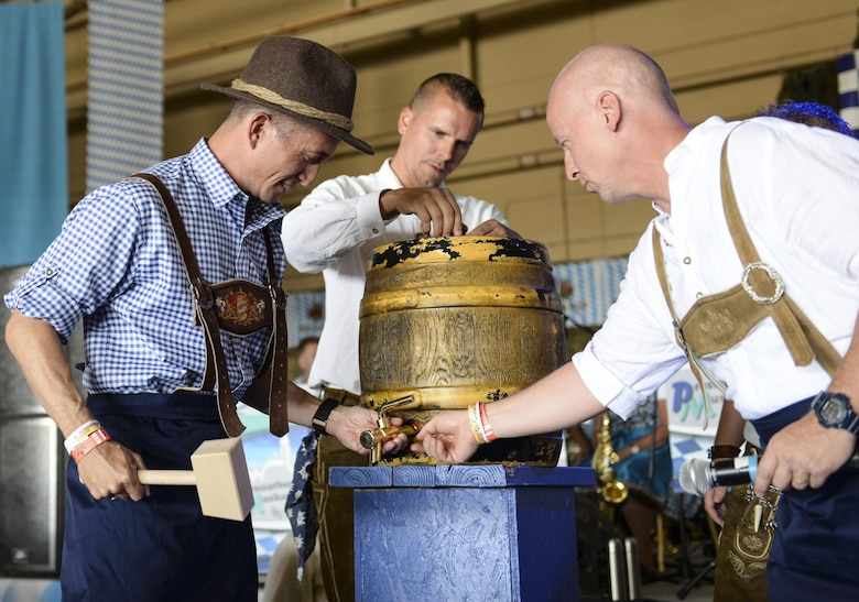 Col. Houston Cantwell, the 49th Wing commander (left), and Col. Stephan Breidenbach, the commander of the German Air Force Flying Training Center (right), prepare to tap the ceremonial keg at the 20th annual Oktoberfest at Holloman Air Force Base, N.M. on Sept. 10, 2016. The German air force has been hosting an annual Oktoberfest at Holloman since 1996. (U.S. Air Force photo by Airman Alexis P. Docherty)
