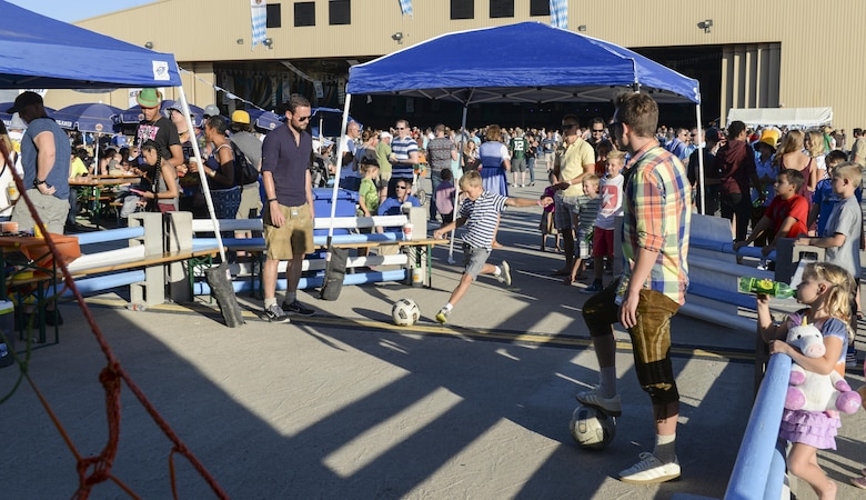 A young boy aims for a soccer net while participating in a game at the 20th annual Oktoberfest at Holloman Air Force Base, N.M. on Sept. 10, 2016. Germany's Oktoberfest is the world's largest beer fest and traveling funfair and is an important part of Bavarian culture. To fulfill the German tradition for German airmen currently stationed at Holloman, the German air force annually hosts its own Oktoberfest. (U.S. Air Force photo by Airman Alexis P. Docherty)