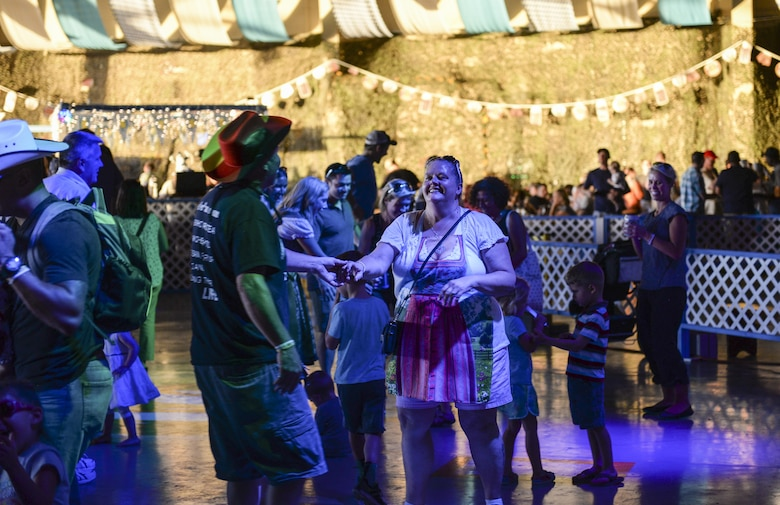 A couple shares a dance at the 20th annual Oktoberfest at Holloman Air Force Base, N.M. on Sept. 10, 2016. Traditional folk music was played throughout Holloman's Oktoberfest. (U.S. Air Force photo by Airman Alexis P. Docherty)