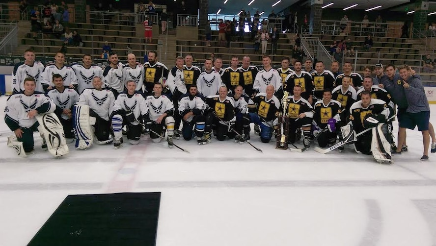 Military members pose for a photo after playing in the third annual William C. Sager, Jr. Air Force vs. Army Memorial Hockey Game, Saturday, September, 10, 2016 in Buffalo, NY. The game was held in remembrance of Tech. Sgt. Bill Sager, a former Remote Pilot Aircraft Sensor Operator with the 107th Attack Wing. (Courtesy photo by Tech Sgt. Anthony Re)