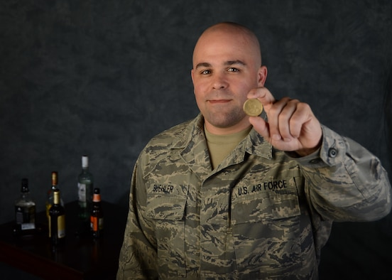 Tech. Sgt. Jeremy Buehler, maintainer with the 131st Bomb Wing at Whiteman Air Force Base, Missouri, holds his sobriety coin that reads One Day At A Time Apr. 8, 2016. Buehler demonstrates mental resilience as he has overcome alcoholism and depression by using psychological and mental health resources offered by the National Guard. Mental fitness is one of four pillars of Comprehensive Airman Fitness in AFI 90-506. Buehler credits his supervisors with saving his career. But, Buehler isn't the only one facing this issue. Suicide is one of the most urgent problems facing the Department of Defense and society. Among the reserves and National Guard, 88 Army, Navy, Air Force and Marine reservists died by suicide in 2015, while 100 Army National Guard members and 21 Air National Guardsmen killed themselves, according to a recent DoD report. The Guard has ongoing education and training programs, as well as psychological health professionals who help create a protective and resilient culture within the wings. (U.S. Air National Guard photo by Airman 1st Class Halley Burgess/RELEASED)