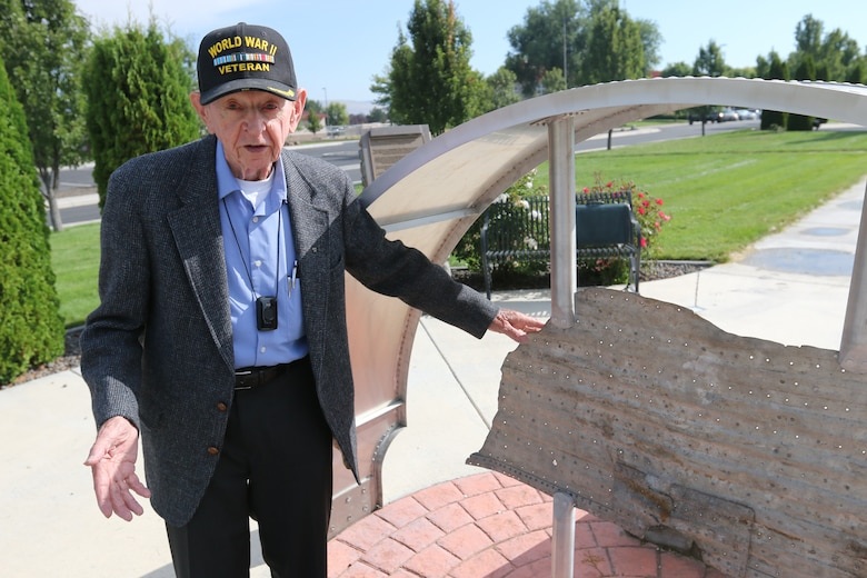 World War II veteran Mr. Joe Rolison, husband to Lt. David R. Kingsley's late sister Phyllis, remembers traveling to Suhozem, Bulgaria and finding this piece of wreckage displayed in the memorial at the entrance to Kingsley Field Air Base in Klamath Falls, Oregon, Aug. 31, 2016. Rolison visited the base to share his stories and a number of historic items of Kingsley's including his journal kept during WWII. (U.S. Air National Guard photo by Tech. Sgt. Jefferson Thompson)