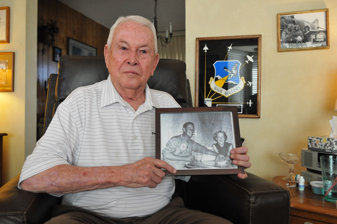 Wayne Adams, 85, holds a photo of him and his mother, Beatrice Adams, at his home in south Reno. The photo was taken at SANGA after Adams won the cross country race from Clearwater, Fla., to Reno during the inaugural National Championship Air Races in Reno in 1964. Photo by Tech. Sgt. Emerson Marcus