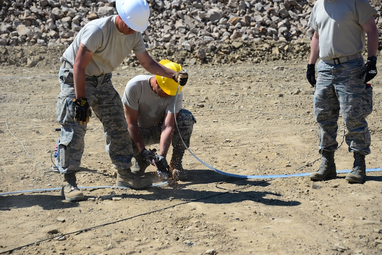 Airmen from the 118th Mission Support Group, Tennessee Air National Guard, construct lightening protection grid work for the Ammo Holding Area, better known as the AHA, Aug. 16, 2016, at Novo Selo Training Area, Bulgaria.  Tennessee National Guard Soldiers and Airmen were on rotations to complete thier portions of projects as part of Operation Resolute Castle 16, an ongoing operation of military construction to build up Eastern European base infrastructure and help strengthen ties between Tennessee's state partnership with Bulgaria. (U.S. Air National Guard photo by Master Sgt. Kendra M. Owenby, 134 ARW Public Affairs)