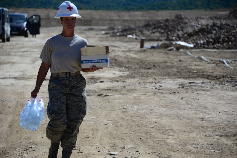 Master Sgt. Rebecca Fraley, medic for the 118th Mission Support Group, Tennessee Air National Guard, construct lightening protection grid work for the Ammo Holding Area, better known as the AHA, Aug. 16, 2016, at Novo Selo Training Area, Bulgaria.  Tennessee National Guard Soldiers and Airmen were on rotations to complete thier portions of projects as part of Operation Resolute Castle 16, an ongoing operation of military construction to build up Eastern European base infrastructure and help strengthen ties between Tennessee's state partnership with Bulgaria. (U.S. Air National Guard photo by Master Sgt. Kendra M. Owenby, 134 ARW Public Affairs)
