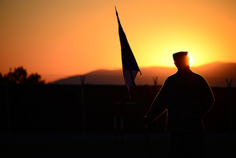 Staff Sgt. Zack Allen, 118th Mission Support Group, Tennessee Air National Guard, stands at parade rest during an early formation Aug. 15, 2016, while deployed to Novo Selo Training Area, Bulgaria.  Tennessee National Guard Soldiers and Airmen were on rotations to complete thier portions of projects as part of Operation Resolute Castle 16, an ongoing operation of military construction to build up Eastern European base infrastructure and help strengthen ties between Tennessee's state partnership with Bulgaria. (U.S. Air National Guard photo by Master Sgt. Kendra M. Owenby, 134 ARW Public Affairs)
