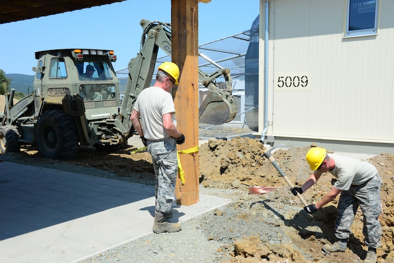 Airmen from the 118th Civil Engineer Squadron, Tennessee Air National Guard, install lightening protection at a pavilion Aug. 10, 2016, at Novo Selo Training Area, Bulgaria.  Tennessee National Guard Soldiers and Airmen were on rotations to complete thier portions of projects as part of Operation Resolute Castle 16, an ongoing operation of military construction to build up Eastern European base infrastructure and help strengthen ties between Tennessee's state partnership with Bulgaria. (U.S. Air National Guard photo by Master Sgt. Kendra M. Owenby, 134 ARW Public Affairs)