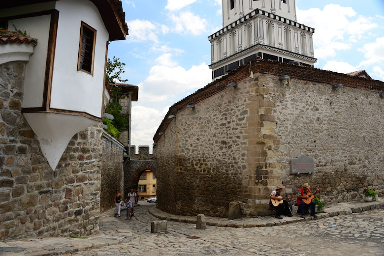 Street musicians play tunes for passerby's on the cobblestone streets of Plovdiv, Bulgaria.  Tennessee National Guard Soldiers and Airmen enjoyed a Morale Wellness and Recreation visit to Plovdiv on Aug.13, 2016 while they were deployed to Novo Selo Training Area, Bulgaria to participate in Humanitarian Civic Assistance projects.    (U.S. Air National Guard photo by Master Sgt. Kendra M. Owenby, 134 ARW Public Affairs)