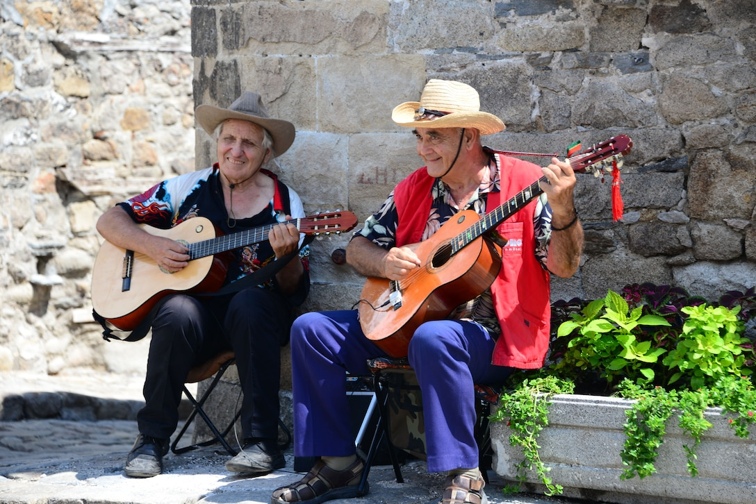 Street musicians perform for passerby's on the cobblestone streets in Nessebar, Bulgaria.  Airmen and Soldiers from the Tennessee National Guard enjoyed touring the area on Aug. 12, 2016 as part of a  Morale Wellness and Recreation event Aug. 12., 2016 while deployed to Novo Selo Training Area, Bulgaria.  Tennessee National Guard Soldiers and Airmen were on rotations as part of Operation Resolute Castle 16, an ongoing operation of military construction to build up Eastern European base infrastructure and help strengthen ties between Tennessee's state partnership with Bulgaria.  (U.S. Air National Guard photo by Master Sgt. Kendra M. Owenby, 134 ARW Public Affairs)