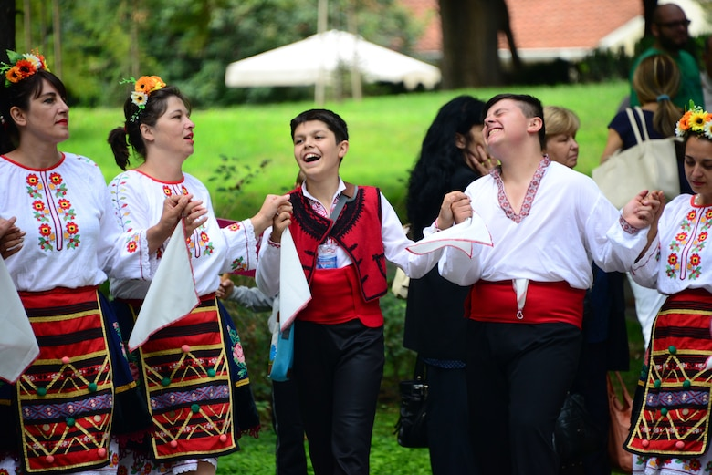 Locals dressed in traditional attire dance and sing in a city park in Plovdiv, Bulgaria.  Tennessee National Guard Soldiers and Airmen enjoyed a Morale Wellness and Recreation visit to Plovdiv on Aug.13, 2016 while they were deployed to Novo Selo Training Area, Bulgaria to participate in Humanitarian Civic Assistance projects.    (U.S. Air National Guard photo by Master Sgt. Kendra M. Owenby, 134 ARW Public Affairs)