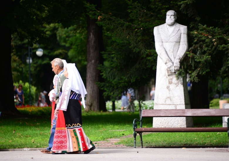 Locals dressed in traditional attire walk through a city park in Plovdiv, Bulgaria.  Tennessee National Guard Soldiers and Airmen enjoyed a Morale Wellness and Recreation visit to Plovdiv on Aug.13, 2016 while they were deployed to Novo Selo Training Area, Bulgaria to participate in Humanitarian Civic Assistance projects.    (U.S. Air National Guard photo by Master Sgt. Kendra M. Owenby, 134 ARW Public Affairs)