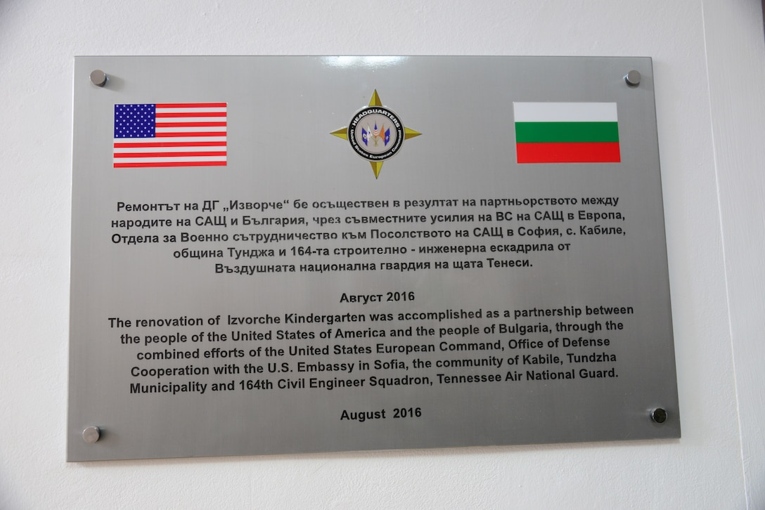 A plaque representing the partnership hangs on the wall permanently at the grand re-opening of the Izvorche Kindergarten school in Kabile, Bulgaria, Aug. 24, 2016.  Tennessee National Guard Soldiers and Airmen from the 164th Civil Engineer Squadron, 118th Mission Support Group, 134th Air Refueling Wing, and the 194th Engineer Brigade deployed to nearby Novo Selo Training Area for thier annual training to participate in Humanitarian Civic Assistance projects such as the renovation of the school.  The projects build skills for the Airmen while helping to strengthen ties with Tennessee and Bulgaria through the State Partnership Program.  (U.S. Air National Guard photo by Master Sgt. Kendra M. Owenby, 134 ARW Public Affairs)