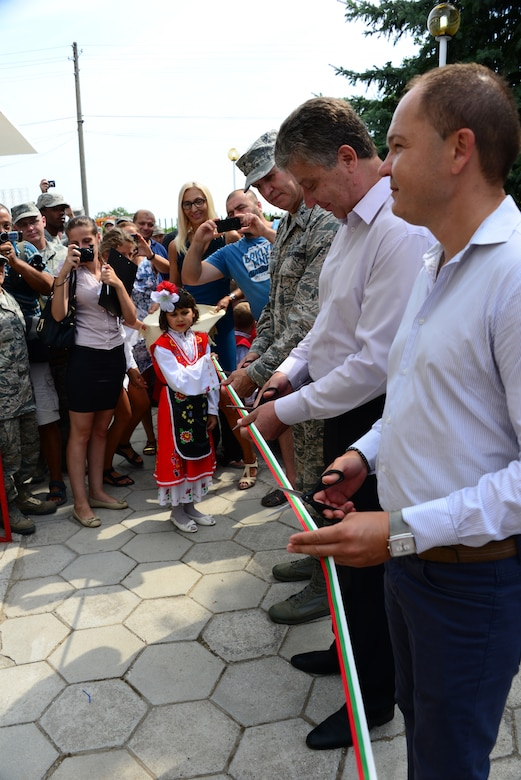 Brig. Gen. Donald Johnson, Assistant Adjutant Gen. (Air), Tennessee, Mr. Georgi Georgiev (center), Mayor of the Tundzha Municipality, and Mr. Dimitar Ivanov, Yambol Regional Governor, cut the ribbon cutting at the grand re-opening of the Izvorche Kindergarten school in Kabile, Bulgaria, Aug. 24, 2016.  Tennessee National Guard Soldiers and Airmen from the 164th Civil Engineer Squadron, 118th Mission Support Group, 134th Air Refueling Wing, and the 194th Engineer Brigade deployed to nearby Novo Selo Training Area for thier annual training to participate in Humanitarian Civic Assistance projects such as the renovation of the school.  The projects build skills for the Airmen while helping to strengthen ties with Tennessee and Bulgaria through the State Partnership Program.  (U.S. Air National Guard photo by Master Sgt. Kendra M. Owenby, 134 ARW Public Affairs)
