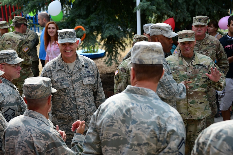 Brig. Gen. Donald Johnson, Assistant Adjutant Gen. (Air), Tennessee, greets Tennessee National Guard members at the grand re-opening of the Izvorche Kindergarten school in Kabile, Bulgaria, Aug. 24, 2016.  Tennessee National Guard Soldiers and Airmen from the 164th Civil Engineer Squadron, 118th Mission Support Group, 134th Air Refueling Wing, and the 194th Engineer Brigade deployed to nearby Novo Selo Training Area for thier annual training to participate in Humanitarian Civic Assistance projects such as the renovation of the school.  The projects build skills for the Airmen while helping to strengthen ties with Tennessee and Bulgaria through the State Partnership Program.  (U.S. Air National Guard photo by Master Sgt. Kendra M. Owenby, 134 ARW Public Affairs)