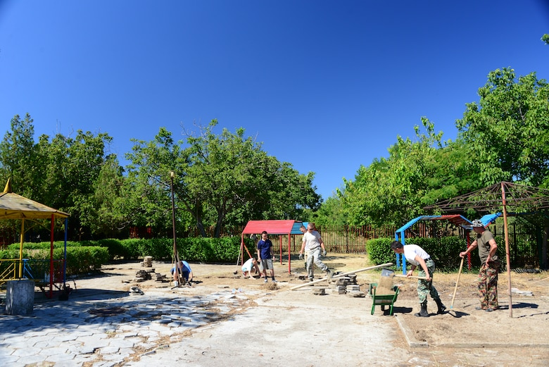 Members of the Tennessee National Guard and the Bulgarian Army work together to renovate the playground at the Izvorche Kindergarten School Aug. 15, 2016.  Tennessee National Guard Soldiers and Airmen from the 164th Civil Engineer Squadron, 118th Mission Support Group, 134th Air Refueling Wing, and the 194th Engineer Brigade deployed to Novo Selo Training Area, Bulgaria for thier annual training to participate in Humanitarian Civic Assistance projects such as the renovation.  The projects build skills for the Airmen while helping to strengthen ties with Tennessee and Bulgaria through the State Partnership Program.  (U.S. Air National Guard photo by Master Sgt. Kendra M. Owenby, 134 ARW Public Affairs)