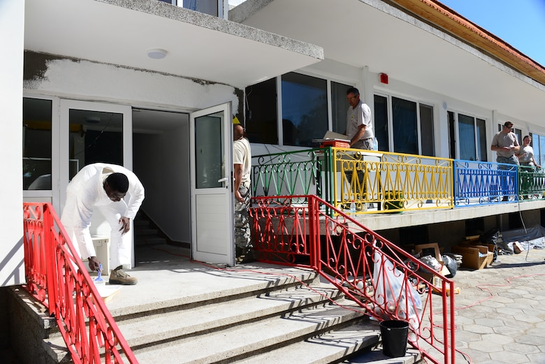 Airmen from the 164th Civil Engineer Squadron, Tennessee Air National Guard, repaint playground equipment at a Bulgarian elementary school Aug. 15, 2016, prior to the new school year.  Tennessee National Guard Soldiers and Airmen deployed to Novo Selo Training Area, Bulgaria to participate in Humanitarian Civic Assistance projects.  The projects help strengthen ties with Tennessee and Bulgaria through the State Partnership Program, while providing skills and labor to those in need.  (U.S. Air National Guard photo by Master Sgt. Kendra M. Owenby, 134 ARW Public Affairs)