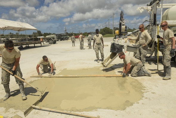 A joint team of U.S. Air Force Airmen from the Kadena, Yakota and Misawa civil engineer squadrons practice concrete screeding skills using the materials, equipment and methods to repair craters during airfield damage repair training exercise Sept, 15, 2016, at Kadena Air Base, Japan. This process can be done quickly in combat situations so airfield operations can resume. (U.S. Air Force photo by Senior Airman Stephen G. Eigel)