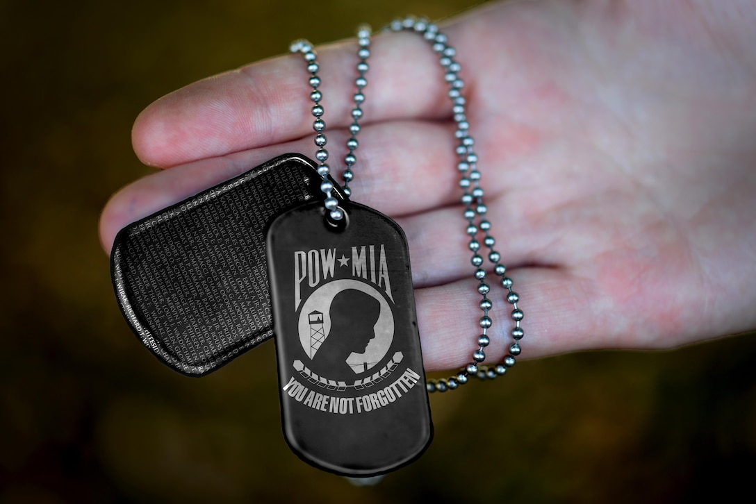 Liberty Wing Airmen observe National POW/MIA Recognition Day at Royal Air Force Lakenheath, England, Sept. 16, 2016. According to the Defense POW/MIA Accounting Agency, more than 83,000 Americans are unaccounted for from past conflicts. (U.S. Air Force photo illustration/Airman 1st Class Eli Chevalier)