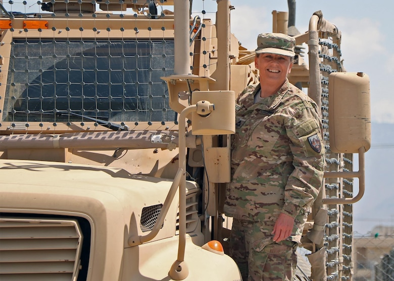 Melissa E. Lewman, the master planning manager and directorate of public works assigned to U.S. Forces-Afghanistan, stands on an armored vehicle at Bagram Airfield (BAF), Afghanistan, May 11, 2016. Lewman was responsible for managing more than 77 high profile projects and overseeing identification and documentation of more than 2,800 properties on BAF. (U.S. Army photo by Jet Fabara)