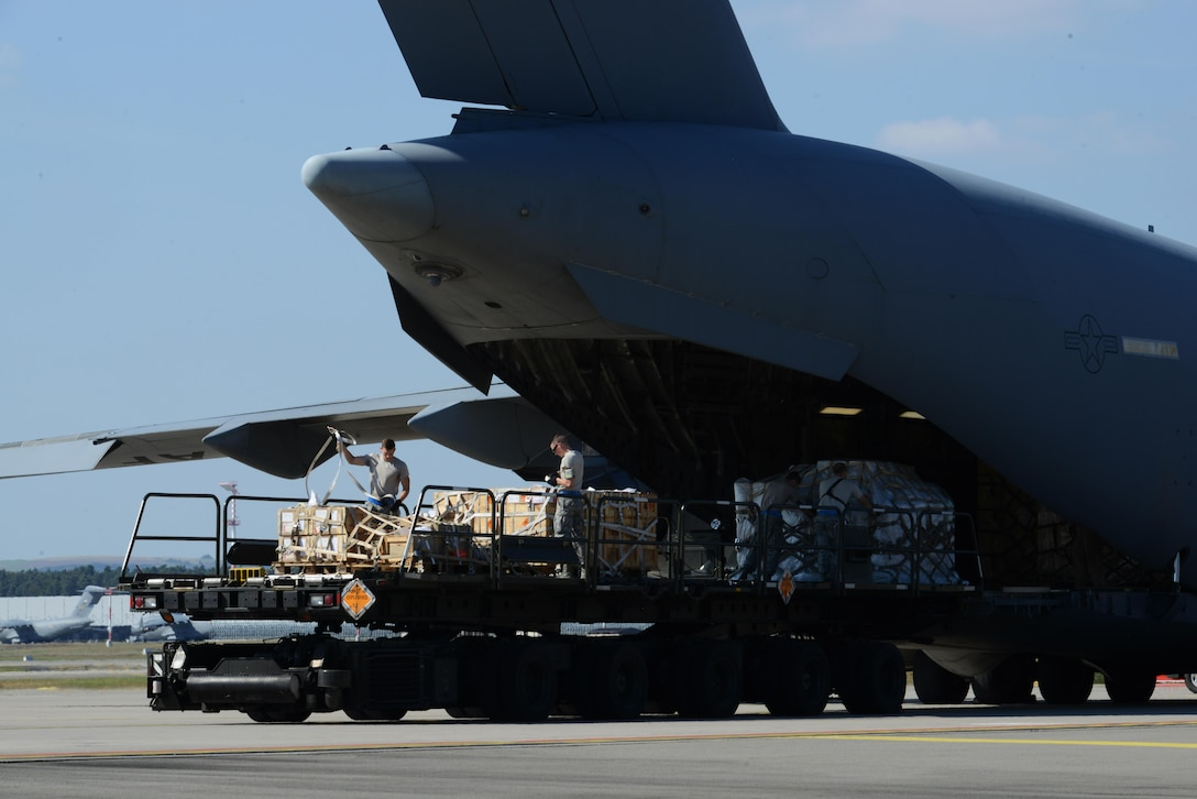 Airmen from the 721st Aerial Port Squadron load a C-17 Globemaster III Sept. 7, 2016, at Ramstein Air Base, Germany. The 721st APS broke a record, July 27, loading 120 tons of cargo onto a Boeing 747, the highest allowable cargo load utilized on any commercial aircraft. (U.S. Air Force photo/ Airman 1st Class Joshua Magbanua)