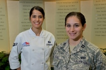Airman 1st Class Raquel Chaparro, of the 436th Force Support Squadron, and Capt. Victoria Martinez, executive officer of Air Force Mortuary Affairs Operations, worked together at AFMAO during Chaparro's deployment at Dover Air Force Base, Delaware. During a recent visit to AFMAO, Chaparro and Martinez discussed the Air Force Academy in front of a memorial wall.
