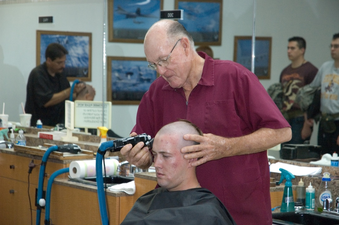 "0 WOT The famous ""Clipper Cuts"" of Lackland Air Force Base. This barber has been clipping hair here for almost 50 years. (U.S. Air Force Photo Training Development Flight)"