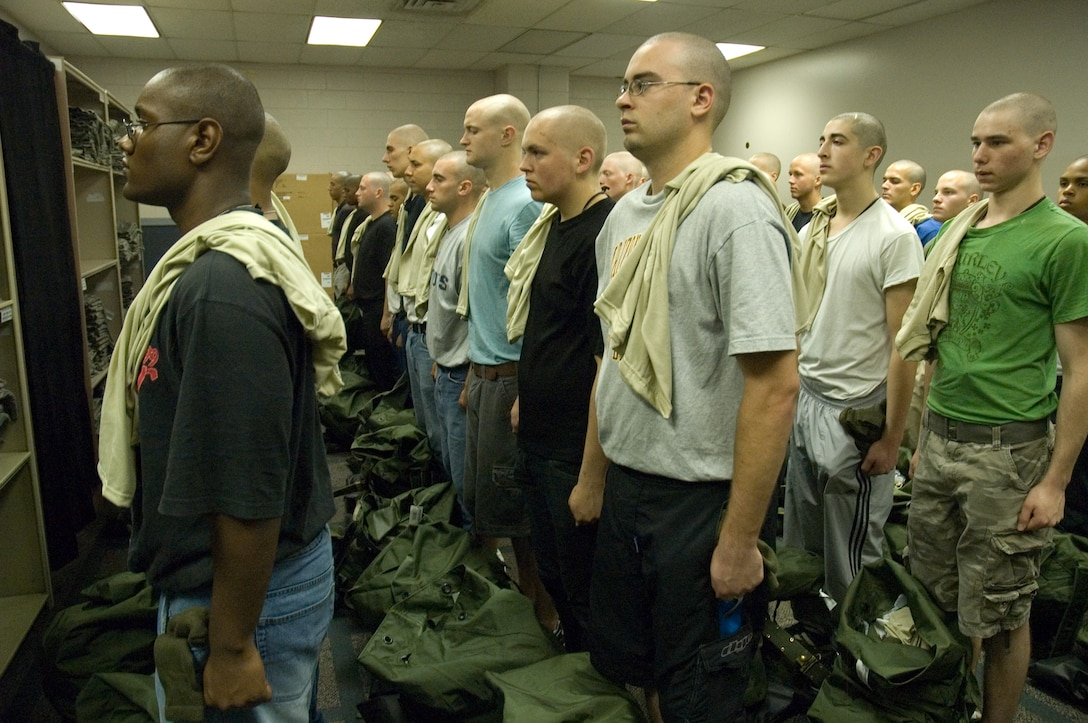 0 WOT Trainees receiving their initial issue of uniforms. (U.S. Air Force Photo Training Development Flight)