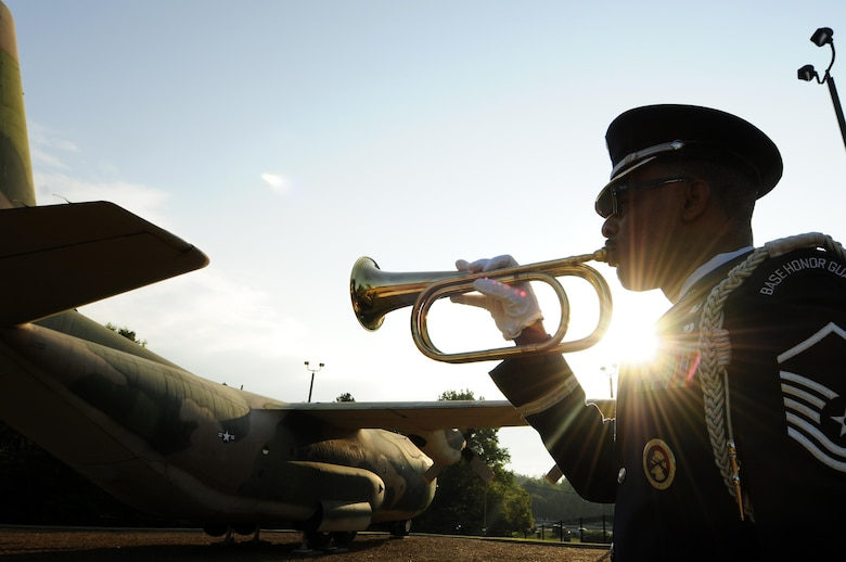 Master Sgt. Brian Adams, from the 145th Force Support Squadron, plays taps to honor the lives lost 15 years ago on Sept. 11, 2001, during a remembrance ceremony at the North Carolina Air National Guard Base, N.C., Sept. 11, 2016. The song is a bugle call traditionally played at dusk, ceremonies, and military funerals; during this ceremony taps was played to honor the lives that were lost. (U.S. Air National Guard photo/Staff Sgt. Julianne M. Showalter)