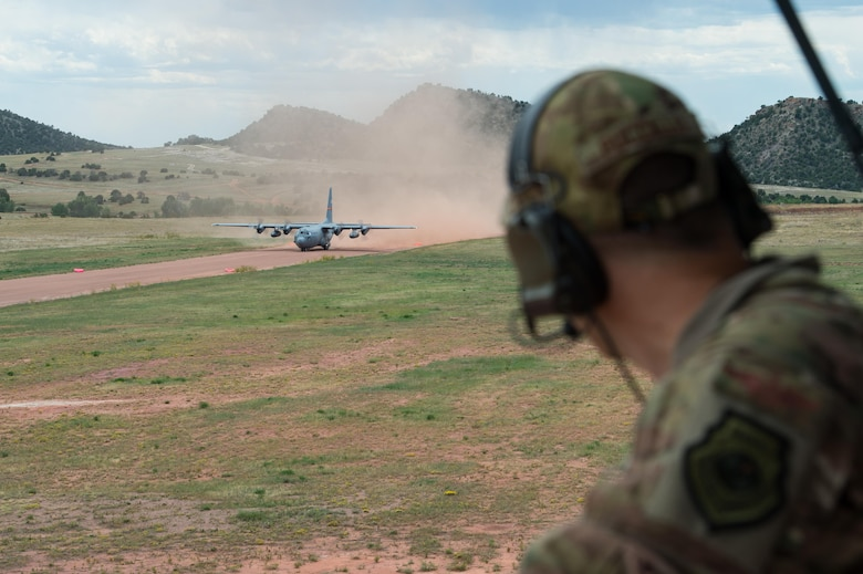 Maj. John Fuccillo, an air mobility liaison officer, looks on as a C-130 Hercules takes off during exercise Cerberus Strike 16-02 at the Red Devil Landing Zone, Colo., Sept. 12, 2016. Contingency response forces rehearsed potential real-world situations by training with Army counterparts during the exercise. Fuccillo is with the 621st Mobility Support Operations Squadron assigned to the Army's 4th Infantry Division at Fort Carson, Colo. (U.S. Air Force photo/Master Sgt. Joseph Swafford)