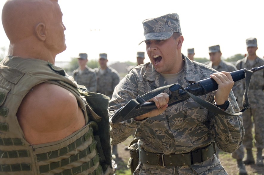 2nd WOT A trainee demonstrates a rifle fighting technique (smash) on a strike dummy during Foundational Expeditionary Skills Training.