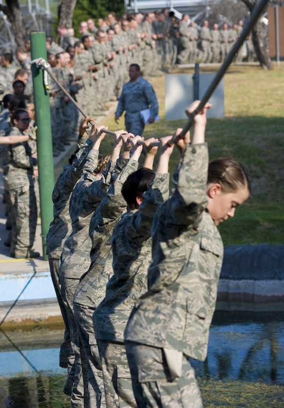 Trainees Crossing A Water Obstacle