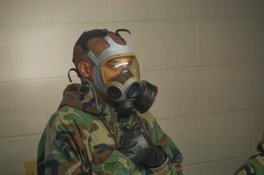 4th WOT Trainee demonstrates proper function of the personal protective mask in the mask confidence chamber.