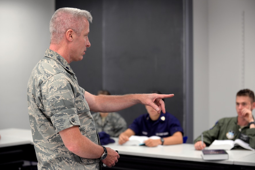 Lt. Col. Bill Uhl, an assistant professor and deputy head of the Philosophy Department at the U.S. Air Force Academy, speaks to cadets in a classroom, Sept. 8, 2016. Uhl suffers from hearing loss but says his qualify of life has greatly improved by the use of hearing aids and assisstive listening technology. (U.S. Air Force photo/Darcie Ibidapo)