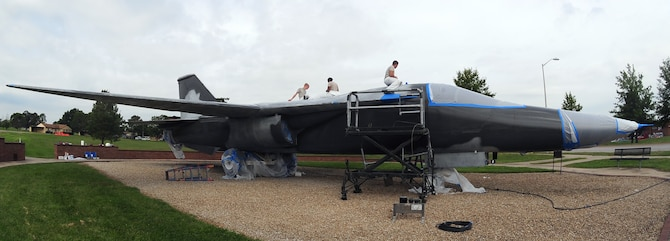 Low observable technicians from the 509th Maintenance Squadron tape off sections of an FB-111A General Dynamics Aardvark static display prior to repainting it at Whiteman Air Force Base, Mo., Sept. 13, 2016. During the restoration process, the aircraft was sanded, primed, repainted and received corrosion maintenance. (U.S. Air Force photo by Senior Airman Joel Pfiester)