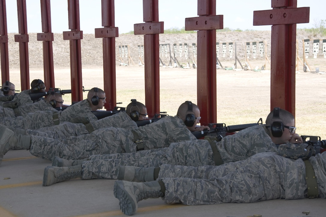 5th WOT Trainees demonstrate the prone firing position at live fire course.
