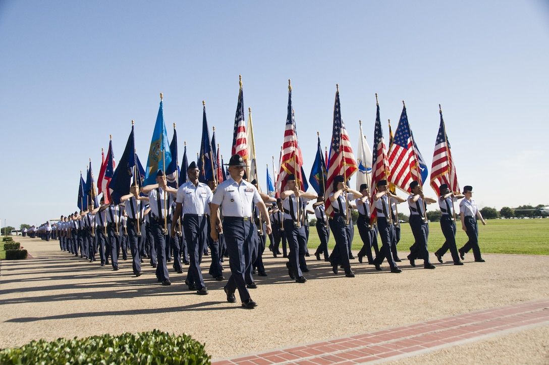 8th WOT Graduation events conclude with Parade. Airmen carry all 50 US state flags each week at parade.