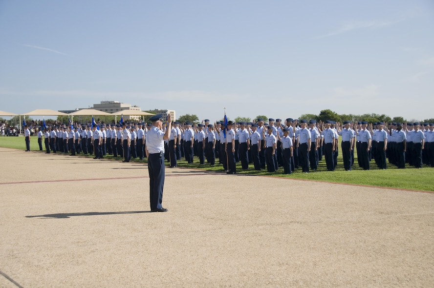8th WOT The administration of the Oath of Enlistment officially indoctrinates the newest Air Force Enlisted members at the Parade Ceremony.