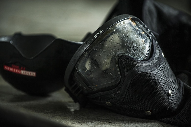 A protective mask rests on a table during combat survival training, Sept. 13, 2016, at Moody Air Force Base, Ga.  As a part of the training, aircrew members fended off teams of opposing forces to test their survival, evasion, resistance and escape skills in an isolated environment. (U.S. Air Force photo by Airman 1st Class Daniel Snider)