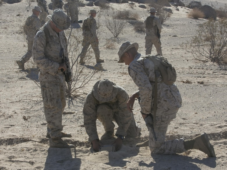 Marines with Company A, 3rd Light Armored Reconnaissance Battalion, practice planting simulated Improvised Explosive Devices at Range 100 aboard Marine Corps Air Ground Combat Center, Twentynine Palms, Calif., Sept. 8, 2016. During the training, the Marines practiced a variety of exercises to include patrolling, land navigation as well as planting and locating improvised explosive devices. (Official Marine Corps photo by Cpl. Thomas Mudd/Released)