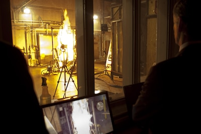 Secretary of the Army John McHugh observes one of the tests used to determine fire-resistant properties of textiles during a visit to the Ouellette Thermal Test Facility, Natick Soldier Systems Center, Natick, Mass., March 15, 2012. Tests such as this have contributed to the development of improved clothing and individual equipment to protect soldiers. Army photo by Spc. John G. Martinez
