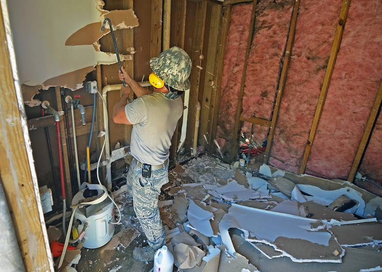 Tech. Sgt. Rickey Schaefer, a structural journeyman with the 556th RED HORSE, demolishes the interior of the softball field press box at Hurlburt Field Fla., Sept. 13, 2016. Inside the press box, the interior walls will be renovated, and the pluming and restroom partitions will be replaced. (U.S. Air Force photo by Senior Airman Andrea Posey)
