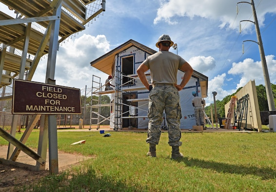 Tech. Sgt. Rickey Schaefer, a structural journeyman with the 556th RED HORSE, surveys the project area as his wingmen renovate the softball field press box at Hurlburt Field Fla., Sept. 13, 2016. The team of craftsman, a blend of reservists from the 556th and 1st Special Operations Civil Engineering Squadron Airmen, renovated the building using funds from the Installation Excellence Award. The $200,000 award is being used to invest resiliency in the force and family by renovating community buildings used for moral events. (U.S. Air Force photo by Senior Airman Andrea Posey)