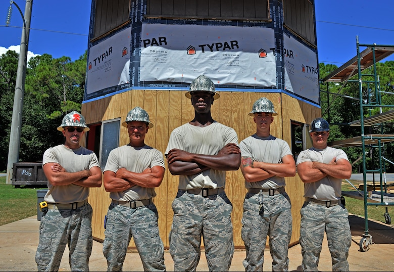 Airmen from the 556th RED HORSE and the 1st Special Operations Civil Engineering Squadron stand in front of the softball field press box at Hurlburt Field Fla., Sept. 15, 2016. Structural specialists are renovating the press box to repair moisture damage in the exterior and interior walls. (U.S. Air Force photo by Senior Airman Andrea Posey)