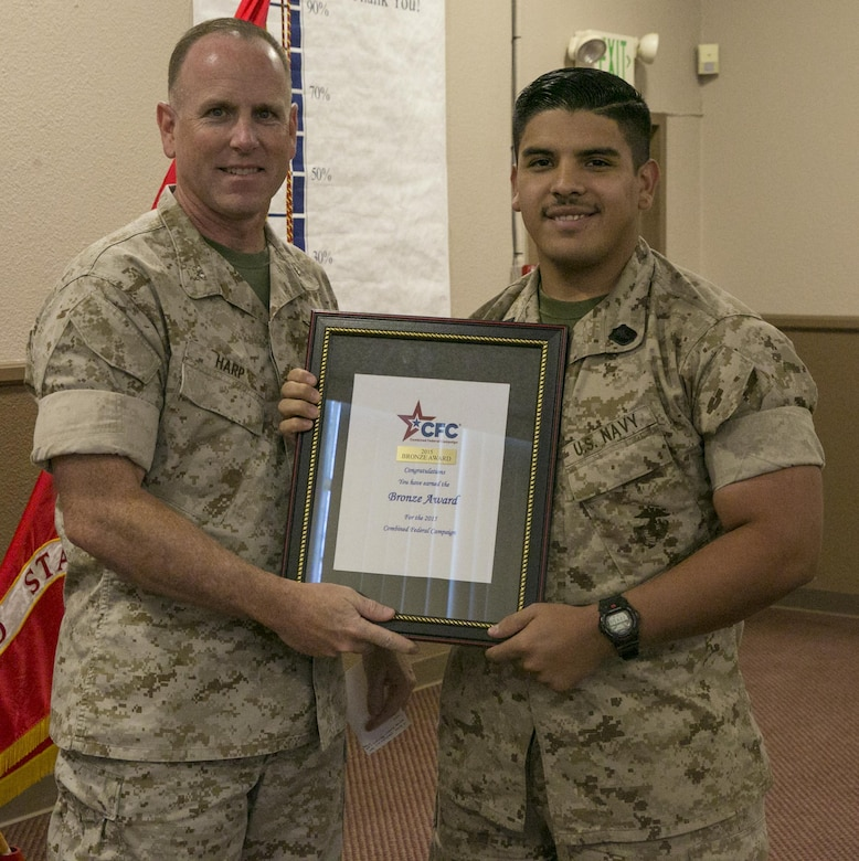 Col. James Harp, Combat Center Chief of Staff, presents 23rd Dental Company, 29 Palms the Bronze Award during the Combined Federal Campaign Kick-off luncheon at Frontline Restaurant, Sept. 9, 2016. The CFC gives the Bronze Award when a unit has had 50 to 60 percent participation or $50 to $65 per capita giving. (Official Marine Corps photo by Lance Cpl. Dave Flores/Released)