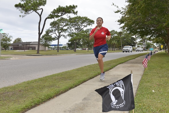 Master Sgt. Laura Alavarez, Continental U.S. North American Aerospace Defense Command Region and 1st Air Force (Air Forces Northern) A-2 Information Security Manager, runs in the POW/MIA Vigil Run at Tyndall AFB.  The 24-hour event was hosted by the 81st Range Control Squadron and included participants from many Tyndall AFB units.  (U.S. Air Force photo by TSgt. Ed Staton)