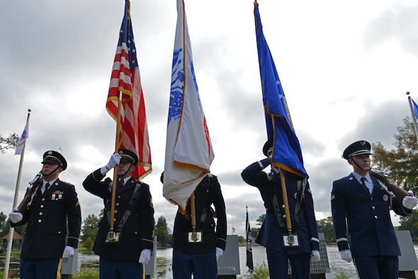 U.S. Airmen assigned to the 20th Force Support Squadron honor guard present the colors during a National POW/MIA Recognition Day ceremony at Shaw Air Force Base, S.C., Sept. 16, 2016. The honor guardsmen, in conjunction with soldiers assigned to U.S. Army Central, provided the presentation of colors, a three-volley rifle salute and played Taps for the ceremony. (U.S. Air Force photo by Airman 1st Class Destinee Sweeney)