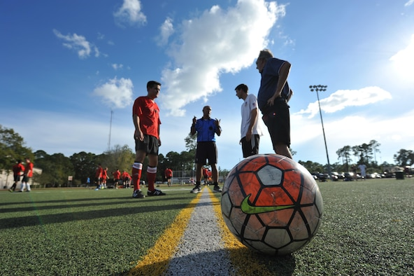 The 319th Special Operations Squadron and the 1st Special Operations Medical Group intramural soccer teams prepare to start the 2016 Intramural Soccer Championship game at Hurlburt Field, Fla., Sept. 13, 2016. The 1st SOMDG defeated the 319th SOS in a double elimination match with a final score of 2-0. (U.S. Air Force photo by Airman 1st Class Joseph Pick)