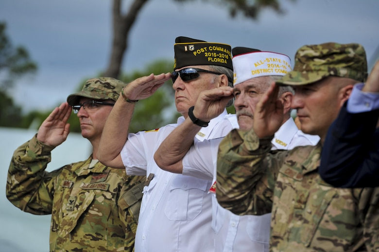 Service members, past and present, salute while the national anthem plays during a POW-MIA ceremony on Hurlburt Field, Fla., Sept. 16, 2016. A 24-hour ruck-march vigil was held in remembrance of prisoners of war and those identified as missing in action that culminated in a ceremony at the Hurlburt Field Air Park. (U.S. Air Force photo by Airman Dennis Spain)